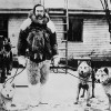 Robert Peary Standing with Dogs